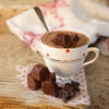 Hot chocolate in vintage teacup with chopped brownie
