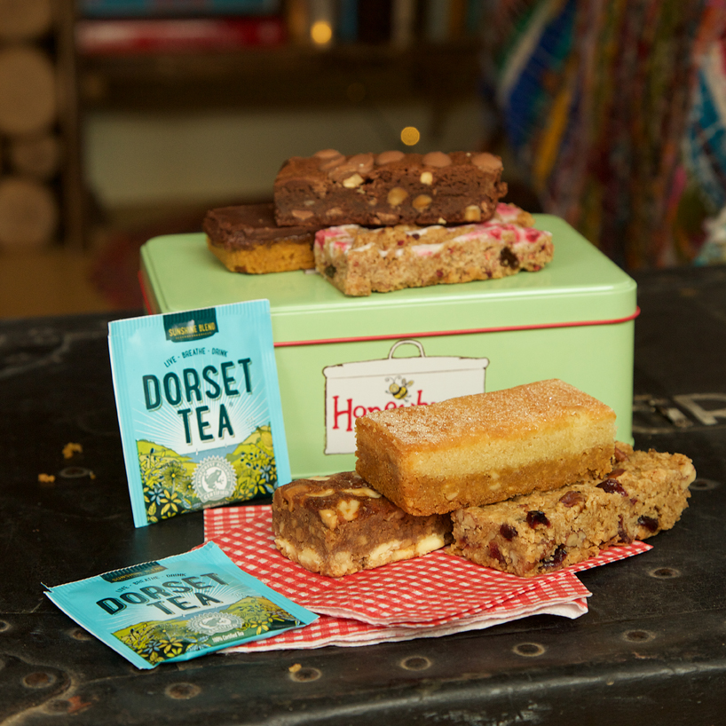 tea party in a tin gift with delicious gluten free cakes