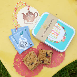 Tea Party in a tin with honeybuns Cranberry & Pecan flapjack, clipper tea bag and cute little tin.
