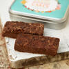 2 brownie slices with little tin with Honeybuns branding