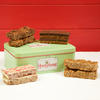 Honeybuns gluten free and vegan cake slices in a cute gift tin